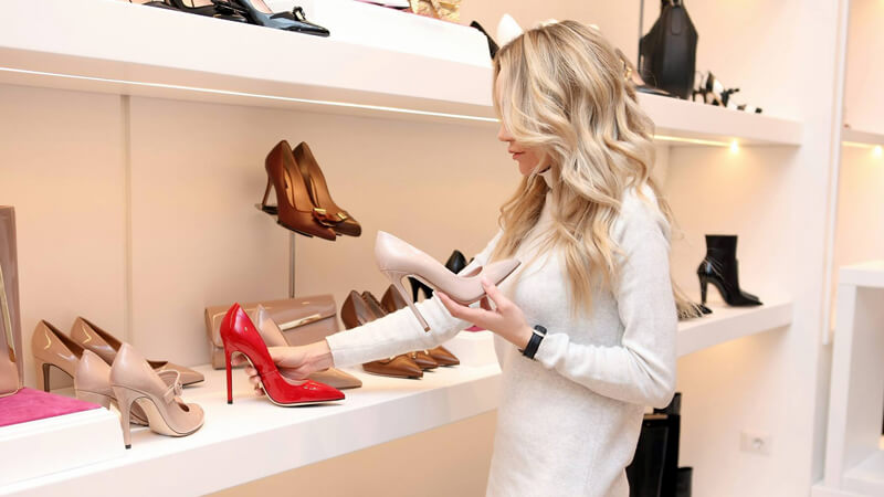 Woman rearranging a shoe display